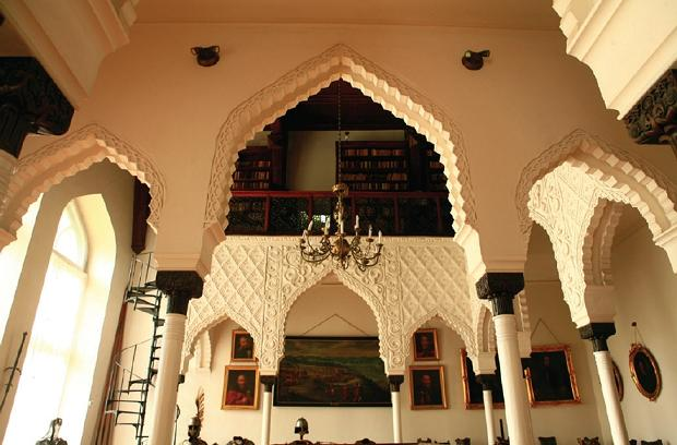 Figure 9: Private library and a collection of patriotic artefacts seen through arcaded Moorish portal of Kornik castle.